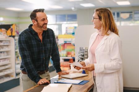 pharmacist and customer discussing Sublocade